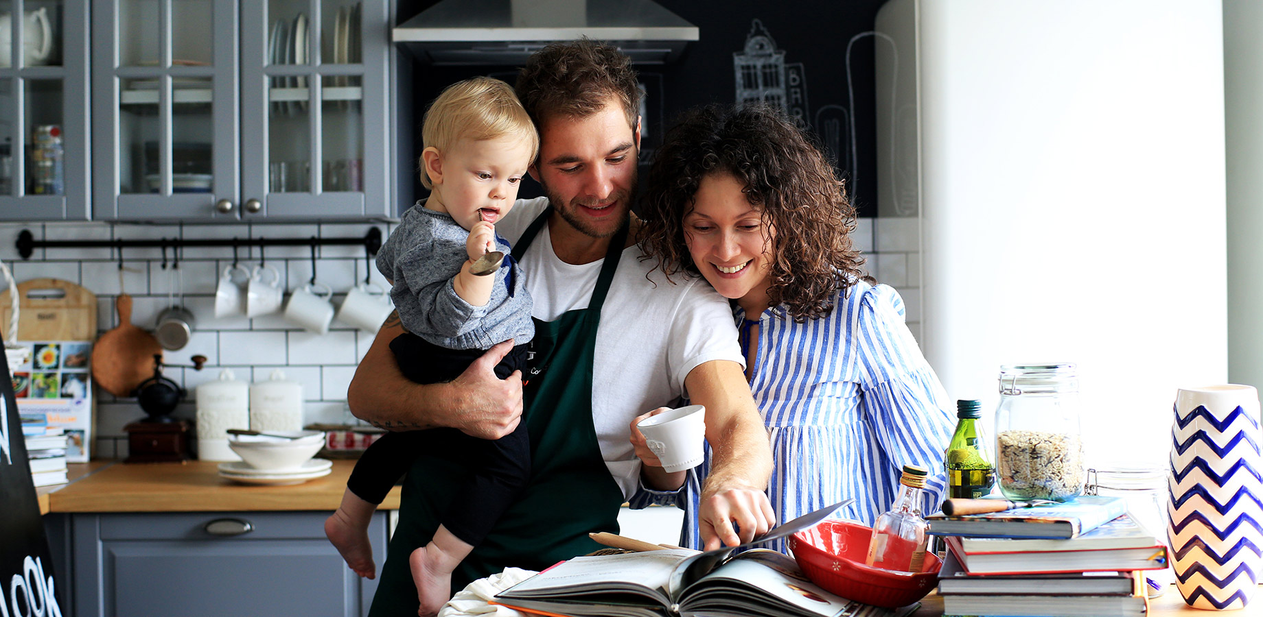 Family cooking in the home to demonstrate the Home & Furniture industry