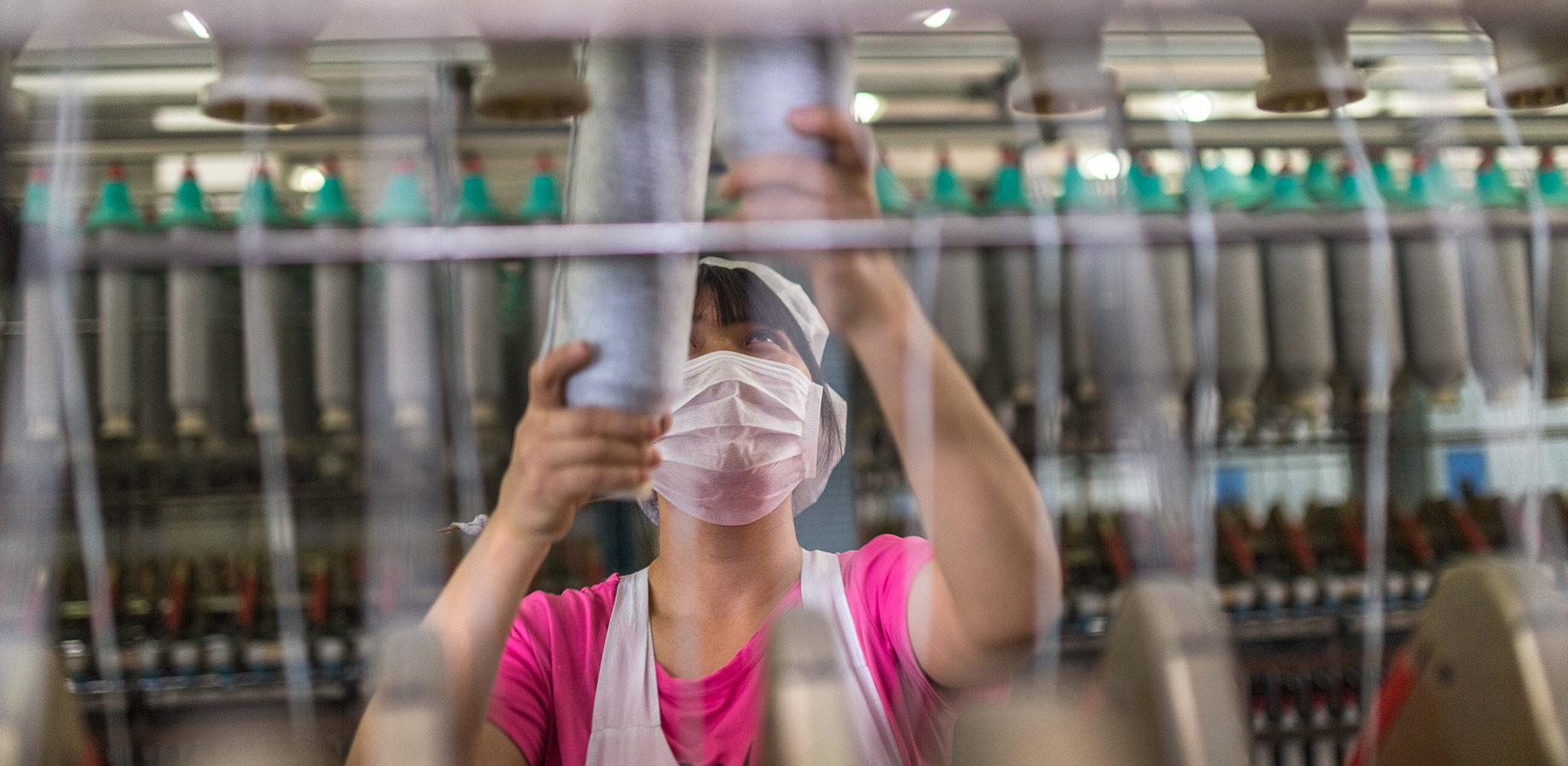 Woman working in a production plant to represent the manufacturing industry